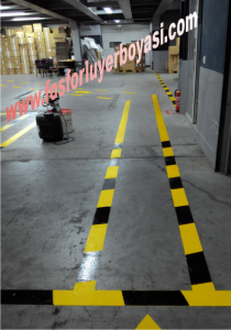 fabrika içi sarı siyah makina parkuru